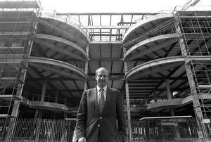 Sir Richard Needham outside CastleCourt shopping centre in Belfast during its construction