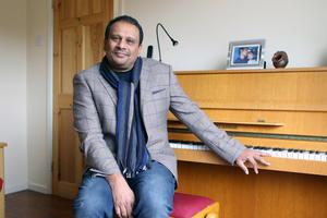 Sunil relaxing at home with his piano