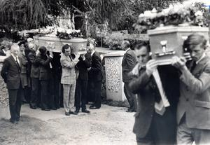 Sad loss: the coffins of James McKee, a retired farmer and his son Ronnie are carried from the family farm at Castleblaney Road,Newtownhamilton