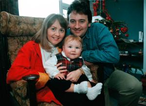 The young reporter with his wife Anne and their baby son Daniel