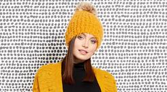 Amber pom pom hat, £10, Amber cardigan, £20 (was £32), polo neck, £18, Amber corduroy skirt, £18 (was £35), Roman