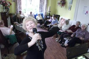 Close bond: Violet Morrison, Van Morrison's mother, entertains members of the Age Concern Day Centre at North Road, Belfast in 2003