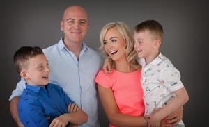 Routine: Karen and Frank Daly with their sons Aaron and Jamie