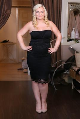Without the corset: Hairdresser Clare Brown demonstrates its effect on her waistline