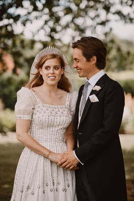 As a hand-me-down Princess Beatrice's wedding gown - borrowed from Her Majesty The Queen - was a bit ritzier than most