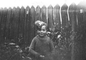 Ron Lutton as a child wearing his big brother Howard's army cap that Howard carried with him on his travels but left with the family in Portadown on his last leave visit, before deploying on Operation Gain