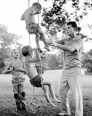 Robert playing with his oldest boys, Joe, Bobby Jr and David, at Hickory Hill in Virginia