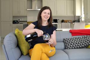 Wine o'clock: Chrissie Russell pouring herself a glass at home