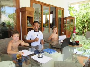 Ben and Tom on their first trip working with a staff member at a villa they stayed at