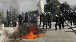 Fanning the flames: people rioted in Greece as the country's financial crisis deepened this week