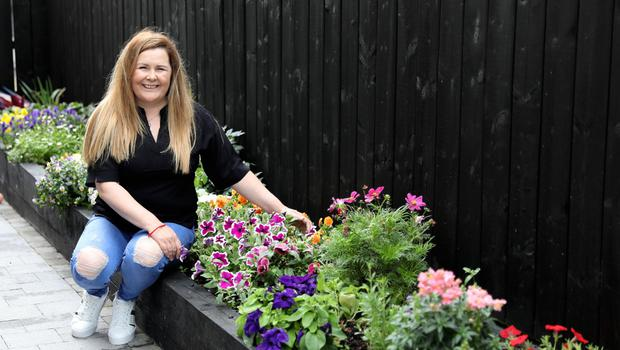 Donna Crilly from Armagh who had a remarkable transformation of her garden using £2 items during lockdown. Photo by Peter Morrison