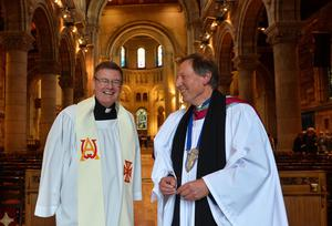 Building bridges: Fr Edward O'Donnell (left), parish priest of St Brigid's, Belfast, after being installed as an Ecumenical Canon of St Anne's Cathedral with Dean John Mann