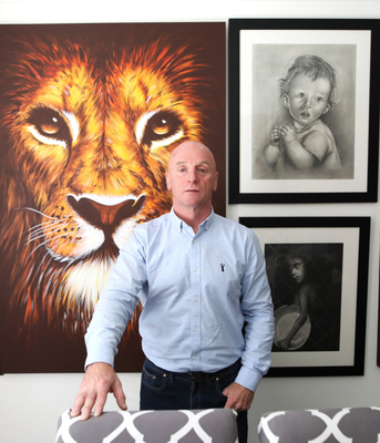 Bobby Mathieson with some of his artwork