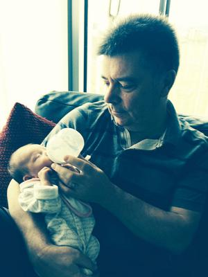 Caring dad: John with daughter Soley as a baby