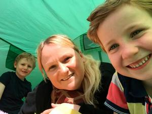 Outside class: Gayle with Hayden and Finn in the family garden