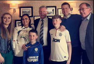Sir Alex Ferguson (centre) and his brother Martin (far right) with Pat and Bernadette McGibbon and their children Alisha, Calum and Shay this week