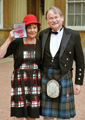 Royal recognition: Julia Donaldson, accompanied by husband Malcolm, receives an MBE at Buckingham Palace for services to literature