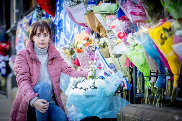 Toni Johnston-Ogle at the spot in Cluan Place where her father Ian was murdered