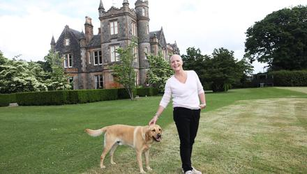 Country retreat: Jane Shaw with her dog George on the historic Elmfield estate in Co Down, where she is hosting a whole food and wellness market. Credit: Peter Morrison