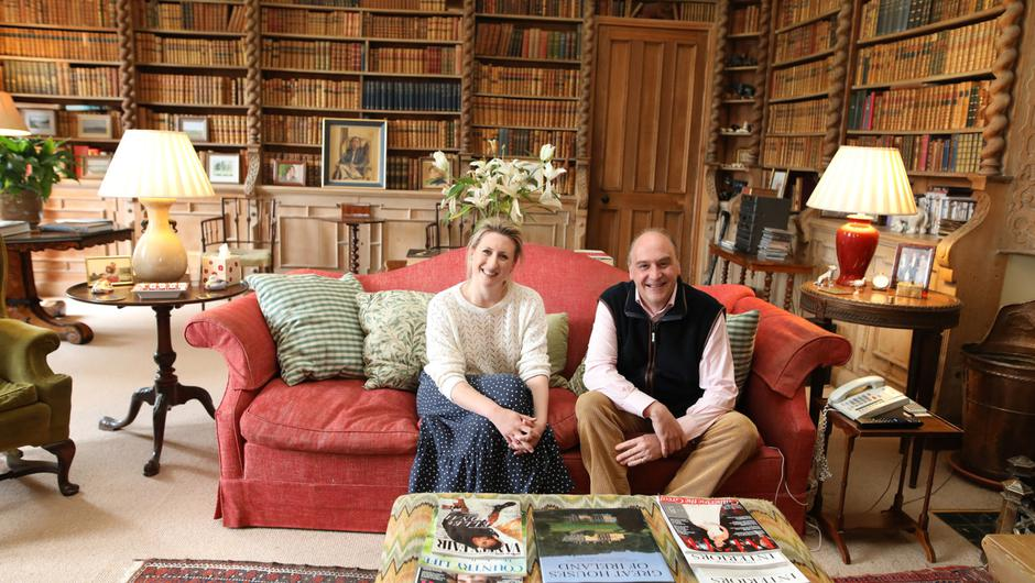 Lord and Lady Erne in the library