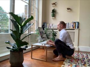 Sitting pretty: Tony Riddle on the floor while working from home