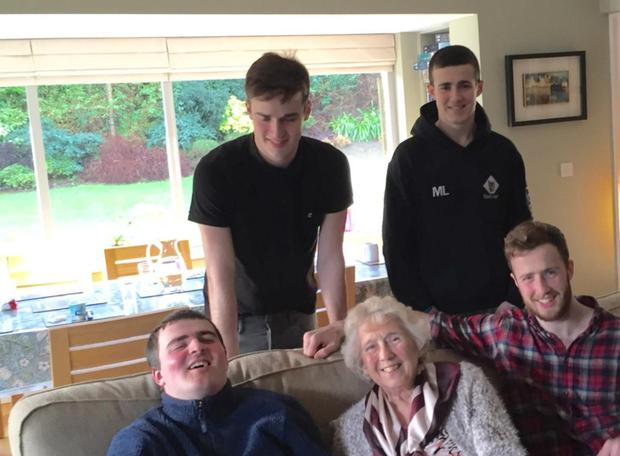 Happy family: June Miller enjoying time with her grandsons Peter and Mark and (front) Patrick and Conor