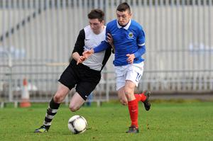 Eyes down: Swifts' Sean Donnelly and Dromara's Gavin McElroy tussle