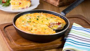 Baked cheddar, tomato and ham omelette