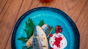 Grilled mackerel with black pepper labneh and pickled red currants