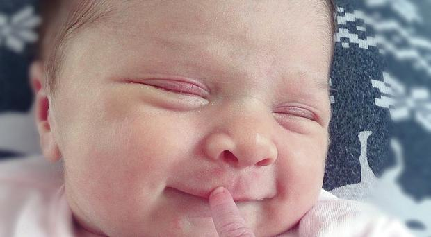 A beaming Penny Rose Bingham. The newborn has been spoilt rotten by relatives and friends, according to mum Lauren