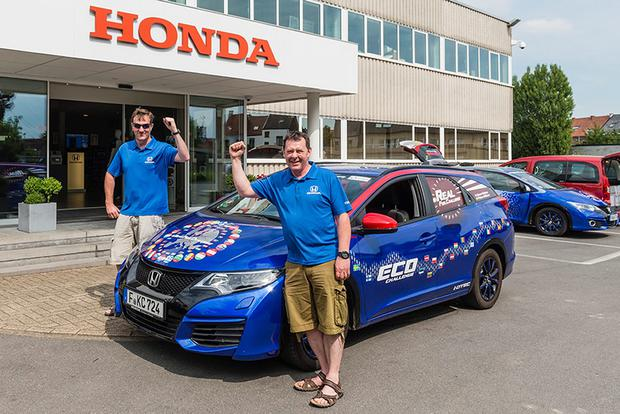 Fergal McGrath (left) and Julian Warren, who spent 25 days behind the wheel of the Honda Civic Tourer 1.6 i-DTEC, as they set a new world record for fuel efficiency by covered 8,387 miles across 24 EU countries - using just £459 of diesel