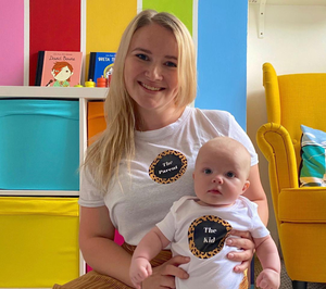 Melissa Suffield and baby River both wearing T-shirts designed by Melissa