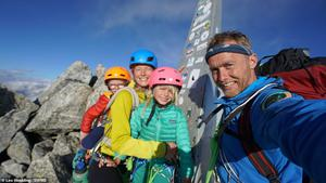 Freya Houlding, seven, (centre) climbed Piz Badile - on the border of Switzerland and Italy - along with her mother Jessica, 41, (left, with three-year-old Jackson on her back) and professional climber father Leo Houlding, 40