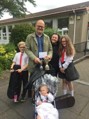 MEMORIES: Kerry and her  family outside the children's school last year