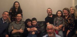 FAMILY MATTERS: Connor with extended family, from left brother Damien, his wife Aoife, sister Ciara holding Connor's nephew Conall, his soon to be brother-in-law Chris Slane who is holding Connor's brother's daughter Meabh Phillips, his mum Maureen Holly and (at front) his dad Terry