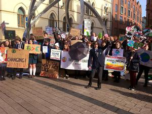 Dara McAnulty in front of a crowd of young environmental activists in Belfast