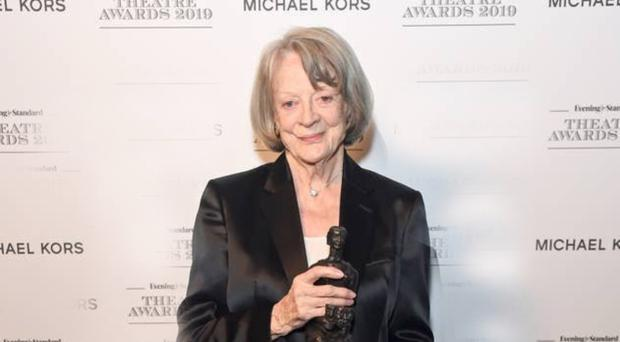 Dame Maggie Smith with her award at the 65th Evening Standard Theatre Awards