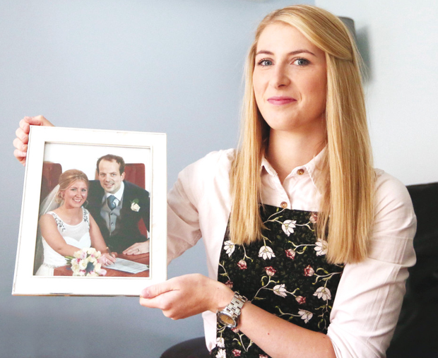 Rachael holding a treasured wedding day picture