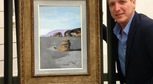 Arthur Brand with Salvador Dali's Adolescence, which he recovered after months of negotiations with criminal gangs
