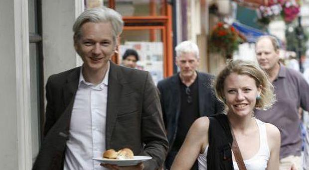 Keeping strong: Julian Assange with Harrison