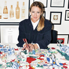 Hands on: Anya Hindmarch with her leather stickers, which have become the accessory hit of the year