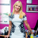 Happy times: Alison Clarke at her modelling agency offices in Belfast