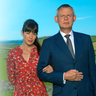 Martin Clunes as Doc Martin and Caroline Catz as Louisa Glasson