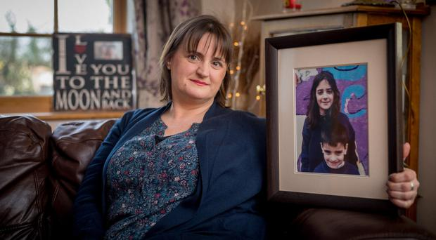 Kathleen Chada with a picture of her sons Eoghan (top) and Ruairi