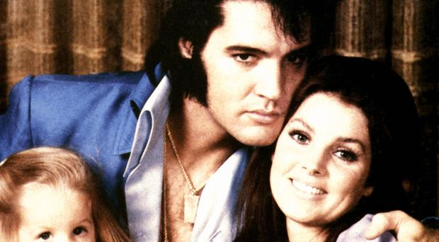 Elvis Presley with wife Priscilla and their daughter Lisa Marie
