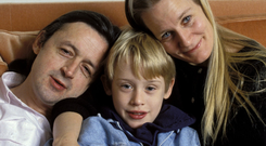Troubled childhood: Macaulay Culkin with mum Patricia and father Kit in 1990