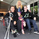 Family ties: John McGuinness with Becky and their kids Maisie and Ewan at the Isle of Man TT after his 2017 NW200 crash. Right, the family celebrates John winning the Senior TT in 2015