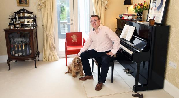 Richard Yarr at home with his dog Alfie