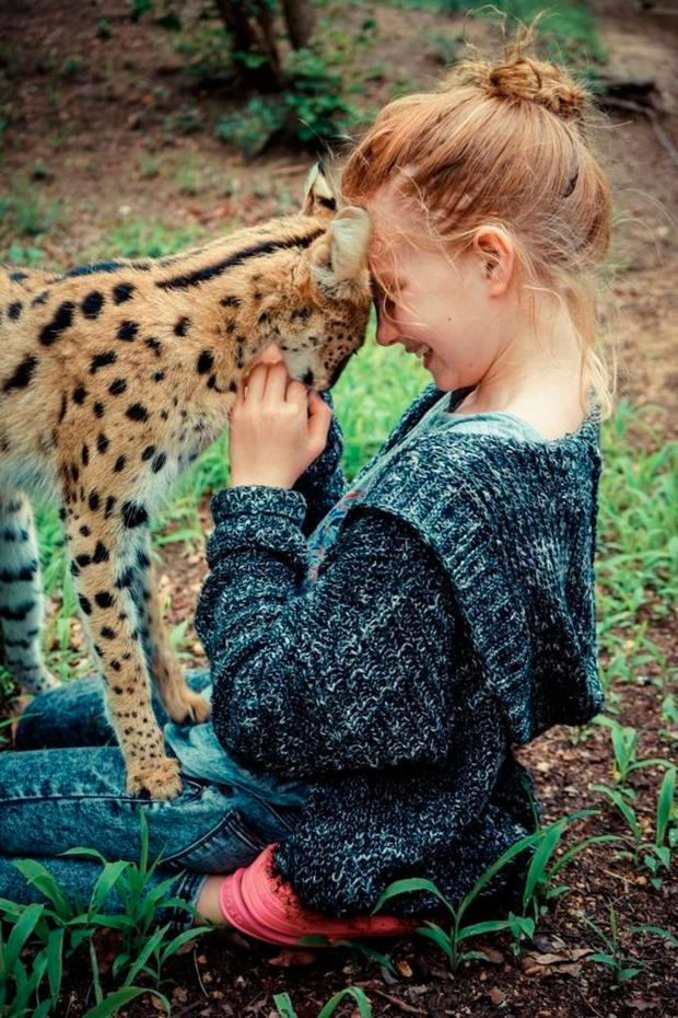 Iris playing with a baby leopard