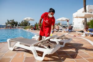 Attendants cleaning sun loungers at the TUI Aura Blue resort.